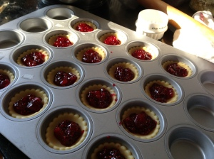 Pastry cut, jam dolloped, ready for the oven.